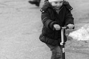 snow sport black and white close-up scooter asphalt movement child winter little girl