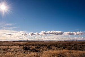 sun dry environment weather sky nature landscape grass color clouds