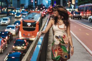 traffic person woman vehicles urban cars