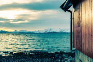 tromsø norway sunset tromso houses cloudly norway sea red houses