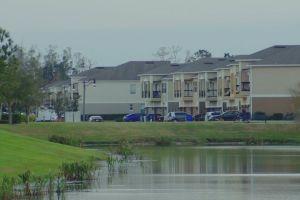 vacation grassland park resort front building villas bike rider facade water