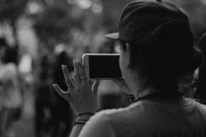white grey photo cap hand black girl phone capture woman