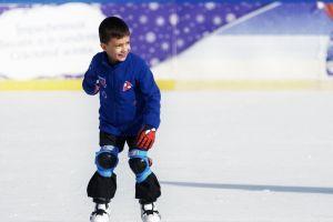 winter ice skating rink little boy skating close-up