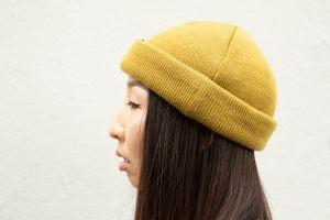 wood hair asian model brown black shirt light reflections hat urban photography tan beanie