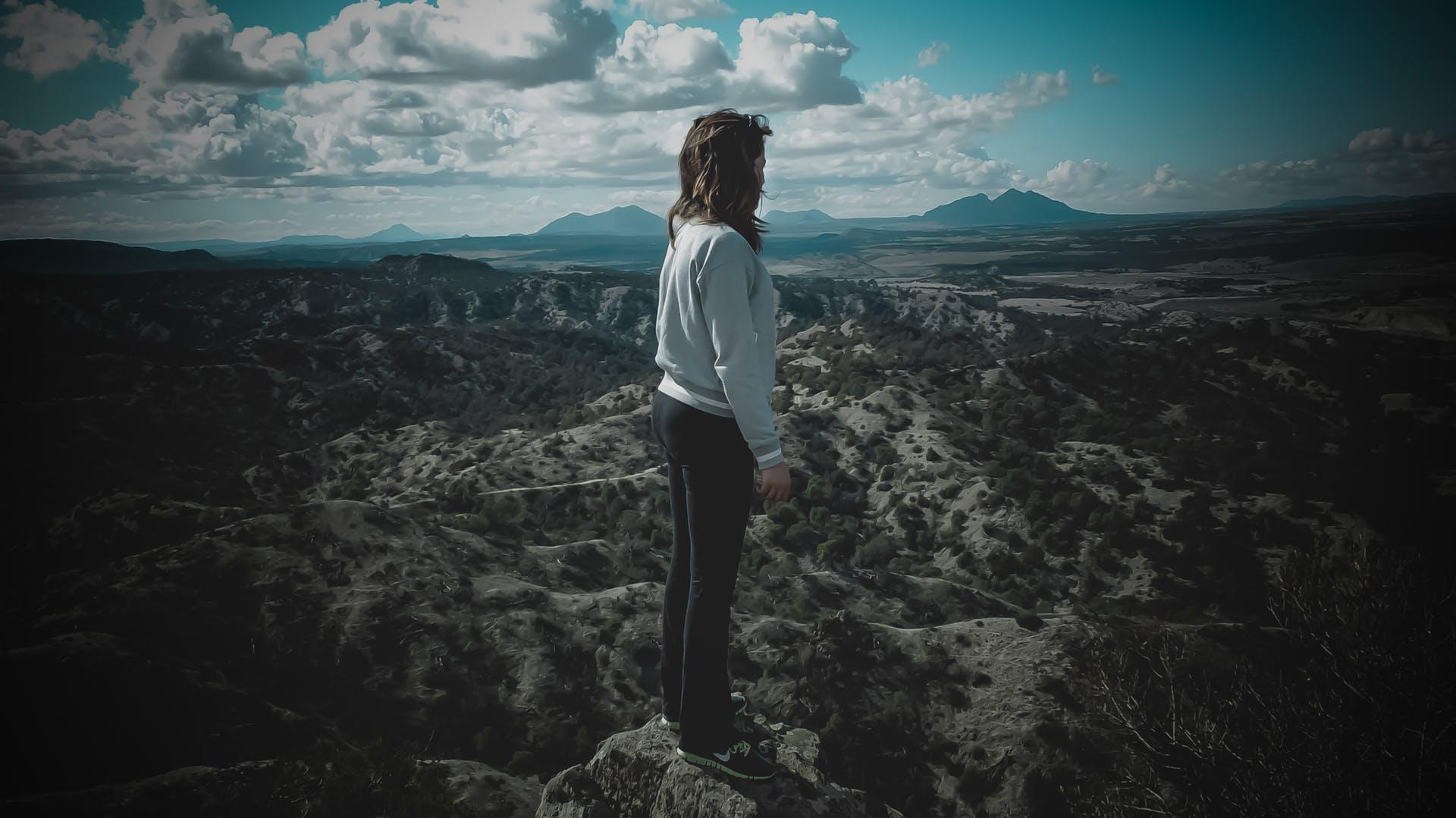 scenic girl sunset rock adventure solitude high person hike mountain climbing