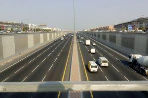 4 lane road road with bridge bridge on road road highway trucks on road