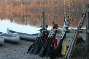 adventure canoes calm waters paddle recreational race beached beach camp