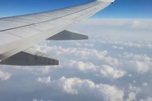 aircraft clouds airplane sky cloudiness transportation system flying heaven wing