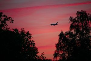 airplane flying clouds purple plane sky sunset color red evening