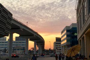 architect metro road golden yellow tourist attraction motor vehicles city lamps evening sun evening sky
