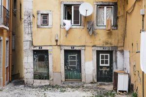 architecture daylight abandoned windows satellite dish doors exterior narrow building dirty