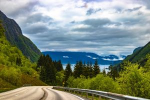 asphalt clouds road daylight scenic highway mountains daytime trees