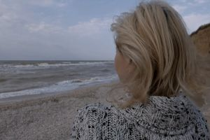 beach shore ocean person lonely sea woman solo seashore windy