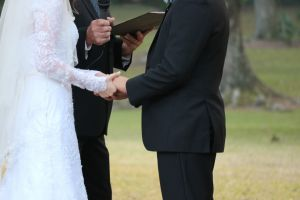 black and white traditional plantation bride holding hands outdoor wedding groom wedding bride and groom outdoor