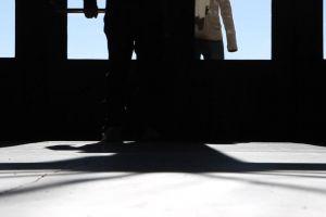 black-and-white walking sunlight door shadow entrance people walks enters