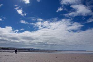blue sky big sky two people sky beach clouds couple
