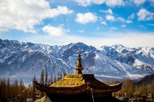 blue sky mountains architecture clouds roof mountain range temple daytime winter trees