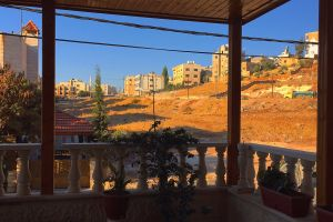 blue sky terrace yellows reds wood
