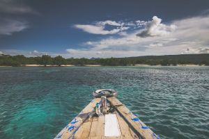 boat deck land fisherman sea sky water landscape blue boat