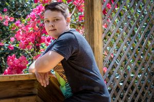 boy pose teenager garden stare relaxed portrait