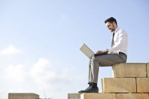 brick work people laptop sky businessman outdoor write wall person
