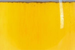 bubble background yellow bottle texture cold lager beverage foam drink