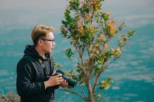 camera person daytime tree man