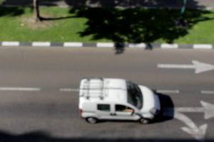 cars blurred vehicles street traffic road