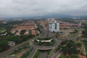 cars high angle shot city traffic buildings aerial shot road