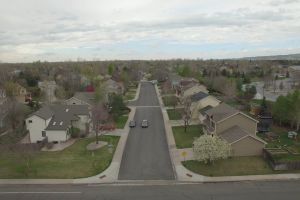 cars village drone footage houses town streets city