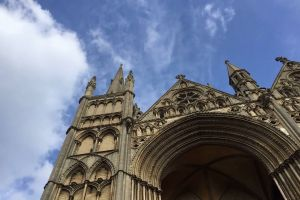 church cathedral gothic time-lapse low angle shot sky clouds historic architecture