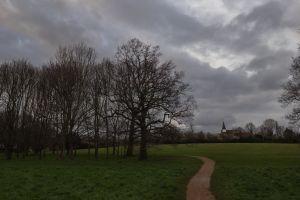 church grass grey skies grey clouds path