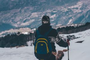 climber daytime person backpack daylight man snow cold clouds