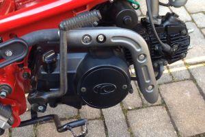 close-up vehicle motorcycle motor pavement engine moped