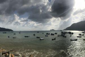 clouds sea sun boats