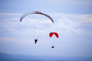 clouds sky paragliders