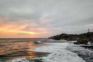 clouds sky sea sun waves sunset seashore seascape landscape sand