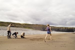 coast sand jump beach children play sky