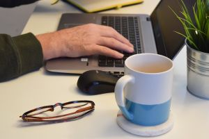 coffee mug home office work laptop mug desk working coffee typing plant