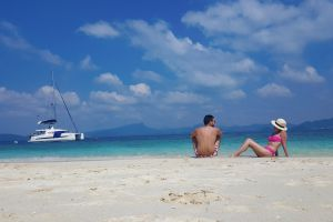 couple beach travelers young couple thailand clear water