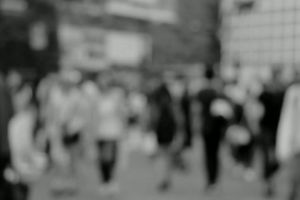 crowded black-and-white crossing bags. travel. tourists walking people crowd street