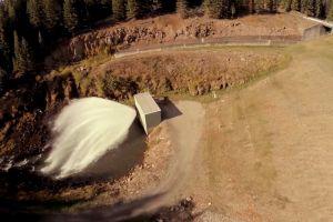 dam person rocks animal dog bridge aerial shot water man nature