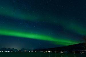 dark night mountains sky stars northern lights aurora borealis