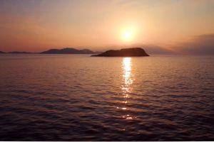 dawn ocean sun water sunset sky islands
