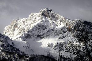 daylight winter landscape peak mountain sky majestic clouds snow scenic trees