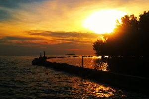 down beach goes sunset sun the harbor