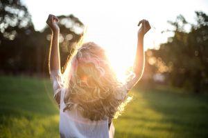 dress female golden sun hands blonde hair young sunset girl wear blurred background