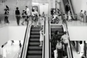 escalators indoors people monochrome black-and-white