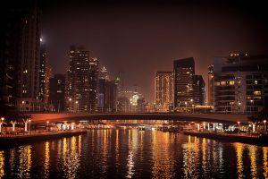 evening modern hotel city of lights dubai buildings long exposure low angle shot illuminated cityscape