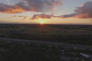 fields sunset dawn wind turbines autobahn road highway sunrise drone footage